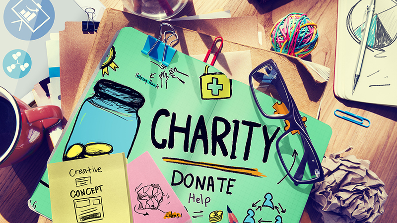 Busy desk with the word 'charity'