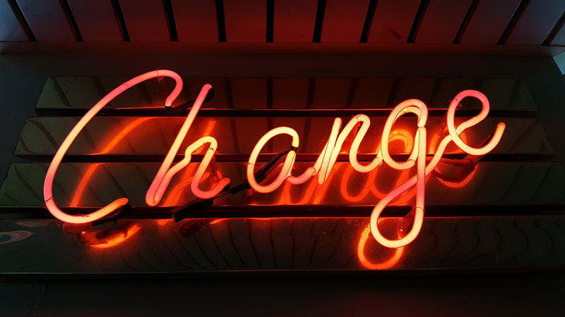 Red neon sign reading 'change'