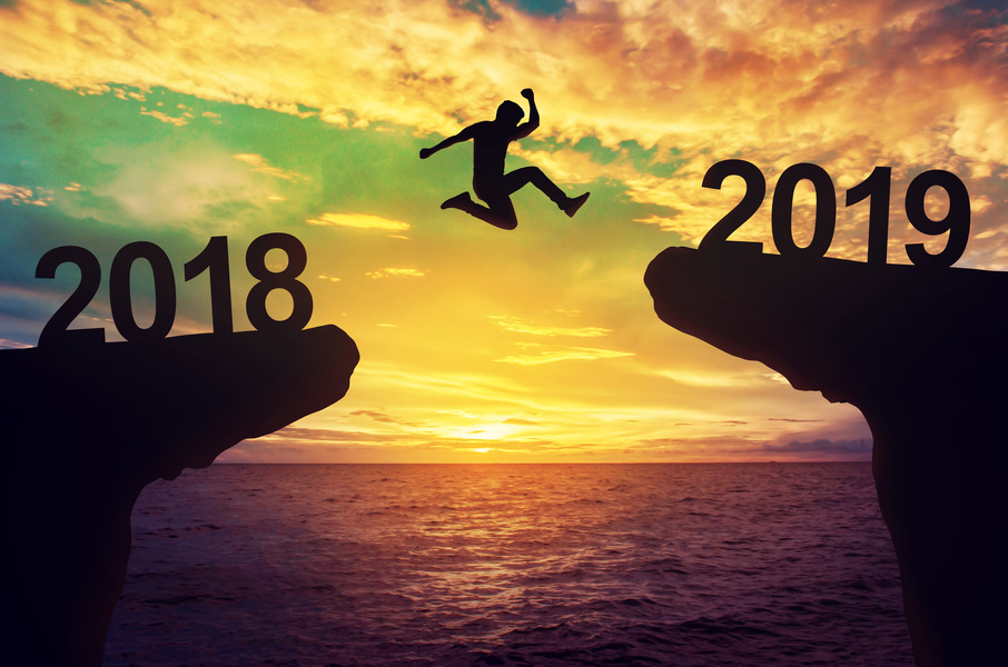 A man jump from 2018 to 2019