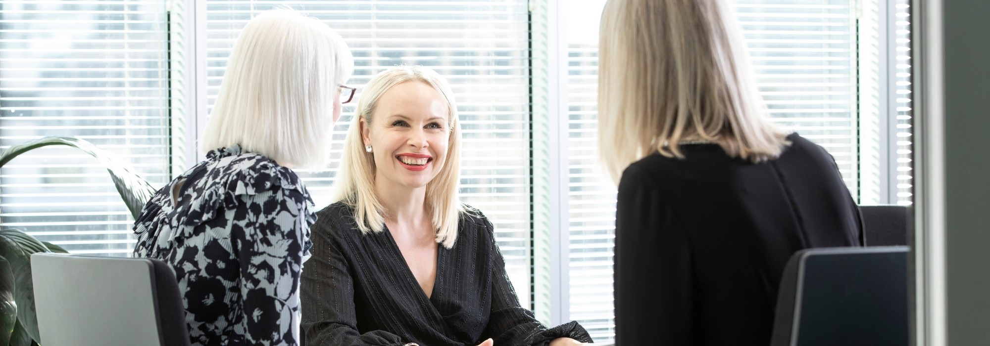 Recruitment Manager smiling in meeting