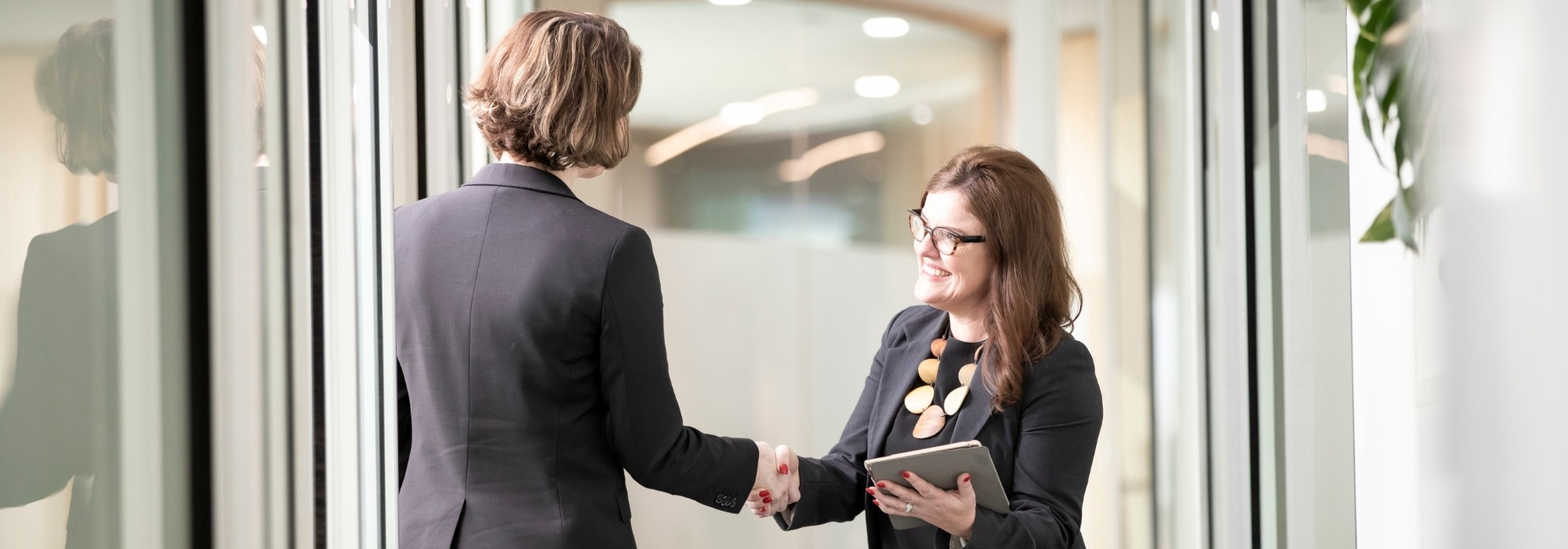 Recruiter shaking hands with client
