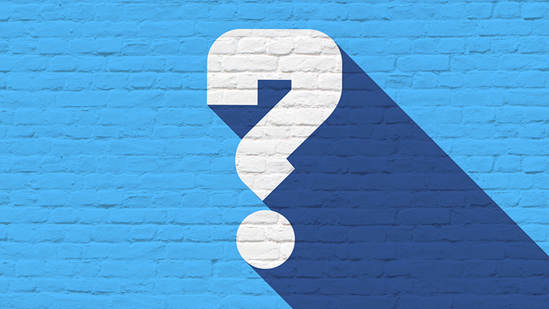 white question mark on a blue brick wall background